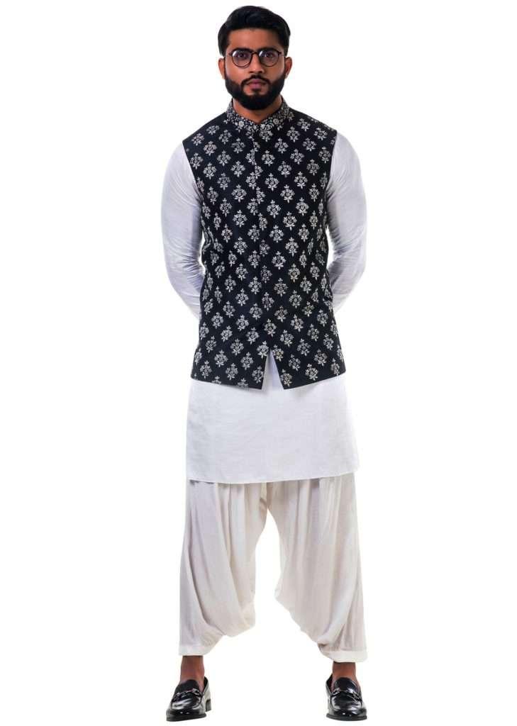 White Kurta Set In Linen Satin With A Black Silk Nehru Jacket With White Cord Floral Embroidery Online - Kalki Fashion