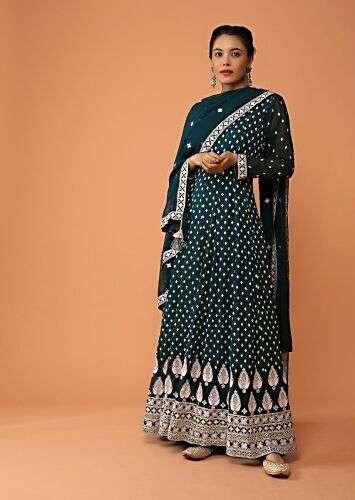 A women posing for a photo wearing Dark Teal Anarkali Suit in georgette by Kalki Fashion