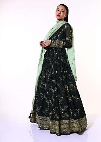 A women posing for a photo wearing Midnight Blue Anarkali Suit in Organza by Kalki Fashion