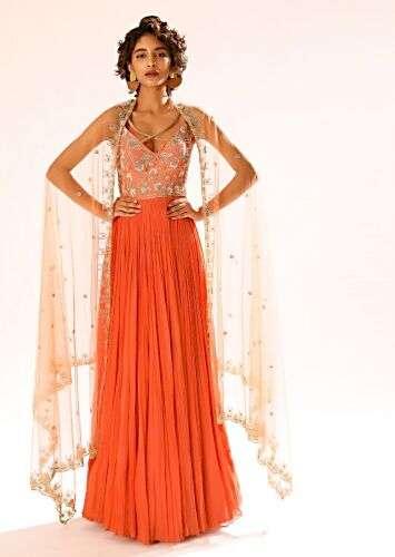 A women having a short hair posing for a photo wearing Tangerine Orange Anarkali Suit by Kalki Fashion