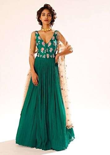 A women having a short hair posing for a photo wearing Teal Anarkali Suit by Kalki Fashion